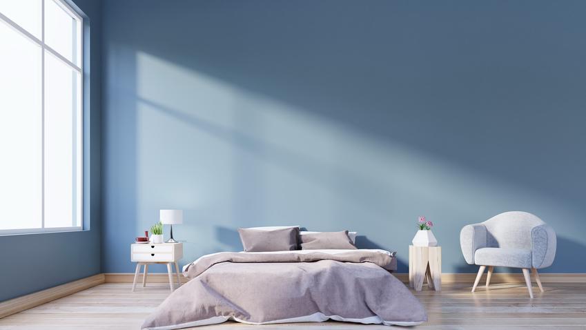 Minimalistyczna sypialnia z niebieskimi ścianami, a także polecane kolory do sypialni
